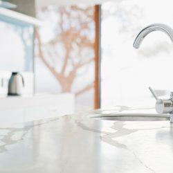 Close up of modern kitchen faucet and sink
