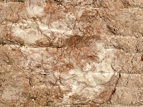 Stone background. Warm colors. Uneven loose texture.